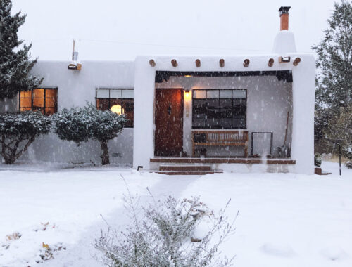 Santa Fe pueblo-style house in the snow - doorsixteen.com